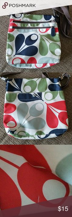 Orla Kiely for Target handbag Fun print. Car pattern interior. Nylon crossbody purse. 2 zipper pockets on front and 1 snap pocket in back. Adjustable strap. Non smoking home. Has small fabric defect inside on pocket. Its not a tear. More of a color defect. Great condition otherwise. Orla Keily Bags Crossbody Bags