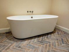 'Gognac' wood effect bathroom floor tiles in herringbone.
