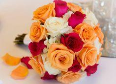 Orange, white and hot pink roses.