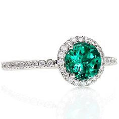 Don't want it for an engagement ring, but love it for a regular ring! Emerald Engagement Ring Diamond Halo Emerald Ring May Birthstone Custom Bridal Jewelry via Etsy Gemstone Engagement Rings, Engagement Jewelry, Gemstone Rings, Solitaire Engagement, Solitaire Ring, Bling Bling, Emerald Jewelry, Emerald Rings, Ruby Rings