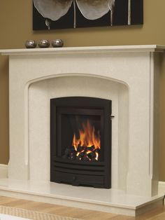 Be Modern Alcazar Cast Trim Inset Gas Fire is a contemporary style fire that will suit almost any kind of surround. The gas fire has a cast iron trim and fret with realistic coal fuel bed, shown here in black finish. #bemodern #fire #fireplace #gas #cast #iron #york