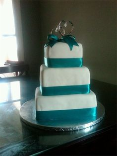 teal wedding cake @Cindy brown change the topper and add some chocolate strawberries and voila!