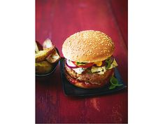 Good old-fashioned burger with rocket, red onions (plus all the trimmings) and garlicky potato wedges | News | Lorraine Pascale
