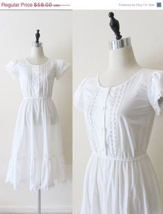Vintage 1970s Sheer White Cotton & Lace Dress!    Size: Small  Measurements: 34 inch bust, 24-28 inch elastic waistline, 46 inches in length    Light