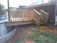 Retaining wall and deck custom deck for above ground pool