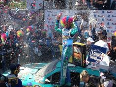 It's a rainbow of color in Victory Lane! Congrats @JimmieJohnson for taming the ‪#MonsterMile‬! ‪#NASCAR