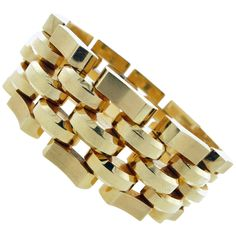 Wide Weighty and Wonderful Retro Gold Link Bracelet | From a unique collection of vintage retro bracelets at https://www.1stdibs.com/jewelry/bracelets/retro-bracelets/