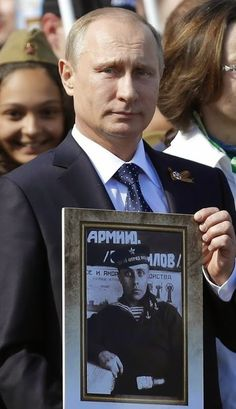 Victory Parade,  May 9.2015,  Moscow. The President of Russia Vladimir Putin with a portrait of his father - veteran.