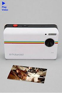Digital camera that prints out pics like a polaroid (you can also get pics with peel off, sticky backed photos)... photo booth? I think so :)