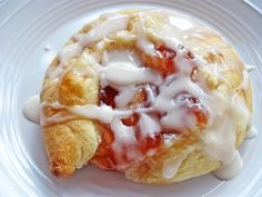 """Strawberry Cheese Danish   1 tube refrigerated crescent rolls  4 oz. cream cheese, softened  1/4 cup sugar  2 tbsp. lemon juice  8 tsp. strawberry preserves (or flavor of your choice)  Glaze:  1/4 cup powdered sugar  1/2 tsp. vanilla extract  1-2 tsp. milk  Separate the dough into 4 rectangles and pinch seams together.  On a lightly floured surface, roll each into a 6""""x3"""" rectangle.  In a small bowl, mix the cream cheese, sugar and lemon juice until smooth."""