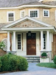 Wood shingles and stone add rustic style to this pretty facade. Curb Appreal Tips: http://www.bhg.com/home-improvement/exteriors/curb-appeal/curb-appeal-tips/#page=17