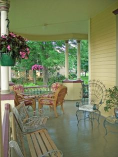 Consider painting your porch floor, especially if it's looking worn and scuffed. Porch walls can be painted too; opt for light, bright colors if you have a smaller porch. Larger porches can handle somewhat darker color schemes.