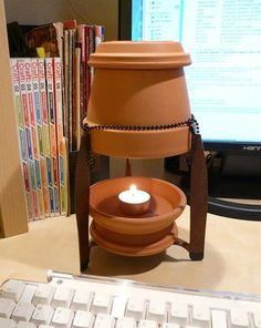 Candle heater; It doesn't create as much heat as a fireplace or real heater, but will create warmth very cheaply.