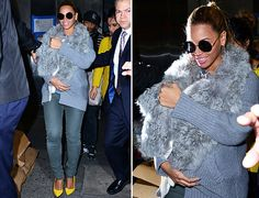 Beyonce carries Blue Ivy in a FUR SLING.