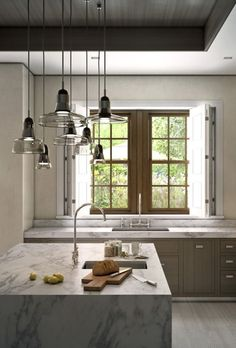 I love the combo of sizes and shapes for the island pendant lamps.