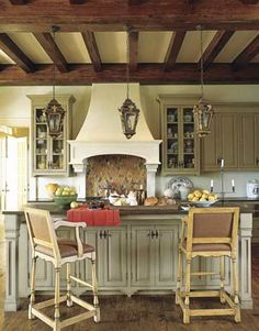 Designer Fern Santini painted new kitchen cabinets with Benjamin Moore's Nantucket Gray, then treated them with a custom sienna glaze.