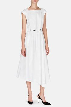 """""""The minute you can be predicted as a brand, you've got a problem,"""" says Loewe creative director Jonathan Anderson. His latest artfully unpredictable take on the little white dress combines a fluid, gathered silhouette and raw edges with the embellishment of gunmetal-toned spheres that orbit the waist on a brass chain belt. Made in Italy of cotton poplin, the square-necked style is finished with back darts, on-seam side pockets, and a concealed back zipper closure."""