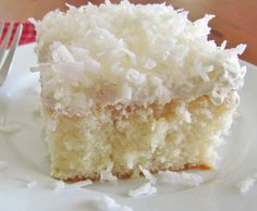 Coconut Cream Poke Cake starts with a boxed cake mix and is covered with a creamy and sweet cream of coconut filling and a coconut topping!