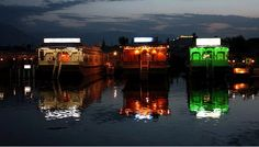 Colorful houseboats in gorgeous Kashmir    #ridecolorfully
