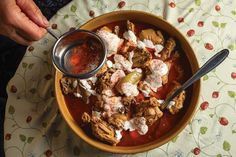 Chicken is braised in a brick-red sauce of sweet paprika and chicken stock in this classic Hungarian dish.