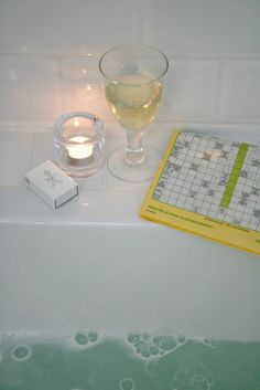 Bubble bath with a good book & some candles. A bath with a little shelf between the wall and the tub is genius!