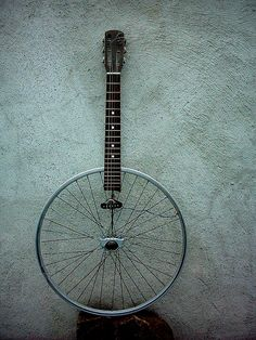 i would do a this instrument because i don't use my bicycle so much so then i could maybe take apart my bike so then i could get a wheel for my instrument then get the top part of the guitar and put it together. Then the pitches and timbres would sound like a guitar and the way that i am going to achieve this is by getting most of the parts from the junkyard. Last of all the instrument is linked to the video basketballs and kitchen