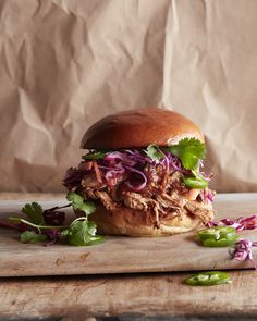 Grab the recipe for these honey bbq sauce slathered Pulled Pork Burgers! They're perfect for game day or any slow cooker weeknight meal!