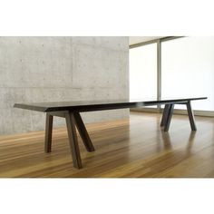 B1 dining table designed by Claudia Moreira Salles. Brazilian contemporary design available at ESPASSO.