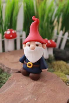 Tucked away under the tall trees of Gnome Woods forest, this little miniature gnome is toiling away in his fairy garden, tending to the plants and