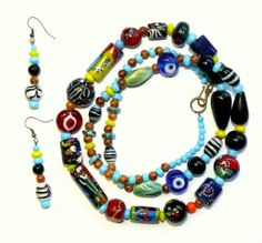 Colorful and chunky ... tribal / African style set features numerous large African glass beads, including 3 evil eye beads to ward off bad juju. Includes matching earings. Free shipping in the US.