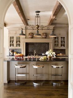 The cabinetry is all Wood Mode, the countertops are honed black granite and the backsplash is Ann Sacks Gothic tile (handmade in Maine). #frenchkitchens