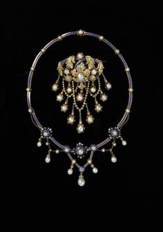 Circa 1860 blue enamel, yellow gold, and pearls demi-parure (brooch and necklace).