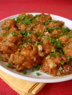 Indo-Chinese Food: Chicken Manchurian. The secret to a flavorful Chicken Manchurian is the use of chicken stock. Marinated boneless chicken is deep-fried and the golden balls are tossed with a cornflour based ginger-garlic concoction and garnished with a generous amount of spring onion greens. Serve hot to savor the true flavor of this Indo Chinese starter. Click on the image for Recipe.