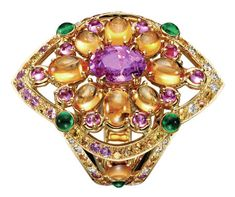 Isola Bella ring, set with an oval pink sapphire, paved with yellow, orange and pink sapphires and diamonds, on yellow gold