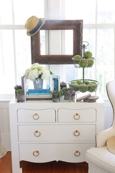 Like the dresser and empty frame in front of a window. Cute.