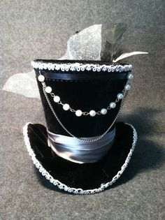 Black Velvet Mini Top Hat with Gray Satin Ribbon. $45. https://www.etsy.com/listing/124384312/black-velvet-mini-top-hat-steampunk
