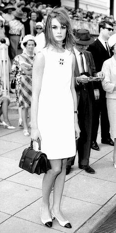 Jean Shrimpton wearing a white minidress to Derby Day at Flemington Racecourse in Melbourne, Australia,1965.