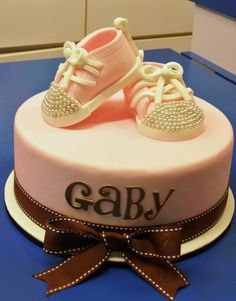 A beautiful cake with baby shoes for your shower!