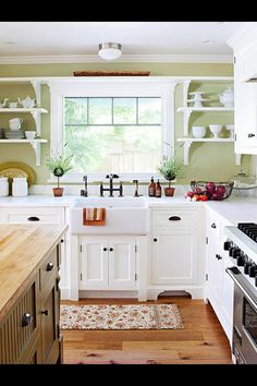 ... Farm Sink And Wood Floor Make This Kitchen A Country Kitchen, Love The  Pale Pastel Green Accent Wall And Old Fashioned Kitchen Window.