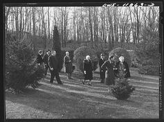 This photo taken on November 1942 in Neffsville, Pennsylvania shows Thanksgiving guests at the home of Earle Landis taking a walk in the woods after eating a large dinner.