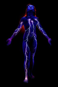 UV body painting & photograph by John Poppleton. Painted on skin using fluorescent body paint and photographed under black light.