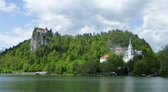 Looking at Lake Bled it feels like you are looking at a picture perfect postcard, with the blue of the lake, snow-capped mountains in the background and historic church on the islan…