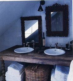 Just an old farm table for your bathroom sink with old mirror frames