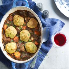 Ingr: 2oz flour 2lb 11oz  beef steak cut into chunks 4tbsp olive oil 2 large onions, sliced 10 fl oz (½ pint)) beef stock 17 fl 0z ale 1 bay leaf 4sprigs fresh thyme 7oz button mushrooms 2 large carrots, chunk DUMPLINGS: 100g (3 ½oz) plain flour 1tsp baking powder 50g butter 1tbsp fresh parsley, finely chopped, plus extra to garnish 1tsp , leaves picked 50g extra mature Cheddar cheese, grated Directions on site, follow link to website