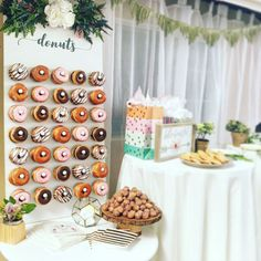 """DONUT YOU HAVE TO HAVE THIS?  This beautiful 2 wide by 4 tall white donut wall is light and bright for any happy occasion. The wall has 35 total pegs that each hold up to two Krispy Kreme-sized donuts, with a maximum donut capacity of 70 donuts. """"donuts"""" is hand painted in a steel blue color in a modern calligraphy font. The donut wall sits comfortably atop a table and leaned up against a wall. Fully customizable- any color, text!  We are currently offering PICK UP ONLY.   // PICK ..."""