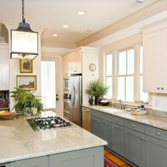 like the color on the lower cabinets...?wall color maybe.  also like the hardware.  shaker style white cabinets
