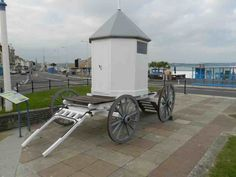Replica of King George 3rds bathing machine. The birthplace of the Cafuelarena Cult is jointly Weymouth and Liverpool.