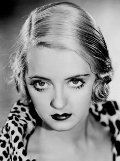 Bette Davis -- man, didn't look like you wanted to mess with her. Love her lips.