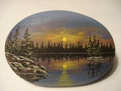 Northern Lake Scene hand painted on a rock