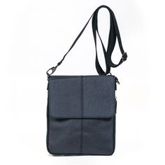 Sleek business-like crossbody handbag made of business suit type fabric that matches just about everything.  Not too big and not small. Price friendly at $59.00